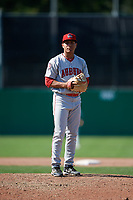 Auburn Doubledays relief pitcher Gilberto Chu (10) gets ready to deliver a pitch during a game against the Batavia Muckdogs on September 2, 2018 at Dwyer Stadium in Batavia, New York.  Batavia defeated Auburn 5-4.  (Mike Janes/Four Seam Images)