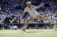 8 July 1990: German tennis player Boris Becker (GER) during his Men's Final match against eventual winner Edberg at the Wimbledon Tennis Championships, London. Photo: Chris Barry/Action Plus...900708.men mens flamboyant