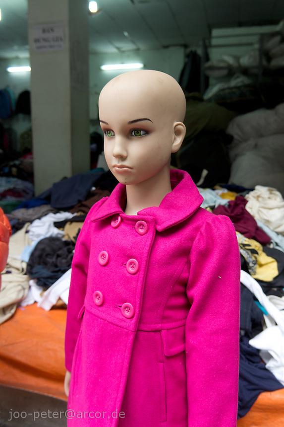 bald plastic manequin in a shop in Hanoi, Vietnam