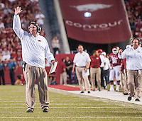 STAFF PHOTO ANTHONY REYES • @NWATONYR<br /> Arkansas head coach Bret Bielema calls out to his players against Northern Illinois University in the third quarter Saturday, Sept. 20, 2014 at Razorback Stadium in Fayetteville. The Razorbacks won 52-14.