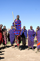 The men from a Masai village near the Serengeti National Park, Tanzania, peform a traditional jumping dance.