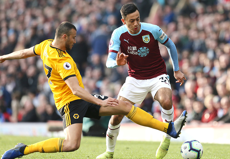 Burnley's Dwight McNeil is tackled by Wolverhampton Wanderers' Romain Saiss<br /> <br /> Photographer Rich Linley/CameraSport<br /> <br /> The Premier League - Burnley v Wolverhampton Wanderers - Saturday 30th March 2019 - Turf Moor - Burnley<br /> <br /> World Copyright © 2019 CameraSport. All rights reserved. 43 Linden Ave. Countesthorpe. Leicester. England. LE8 5PG - Tel: +44 (0) 116 277 4147 - admin@camerasport.com - www.camerasport.com