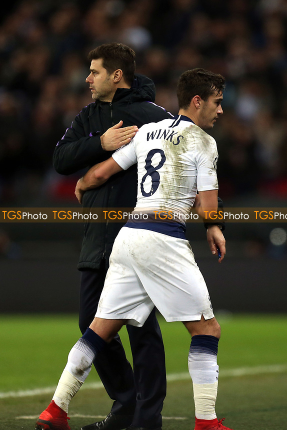 Harry Winks of Tottenham Hotspur is substitutes and Tottenham Hotspur manager Mauricio Pochettino shows his appreciation during Tottenham Hotspur vs Inter Milan, UEFA Champions League Football at Wembley Stadium on 28th November 2018