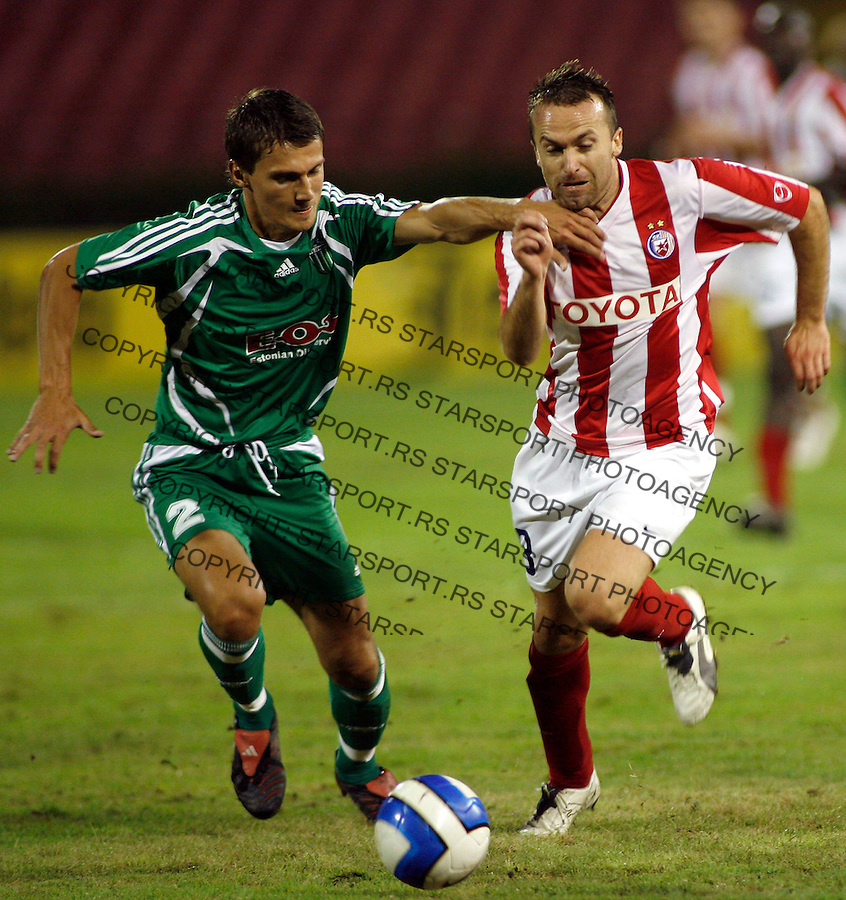 Red Star (Crvena Zvezda) Belgrade player Ognjen Koroman, right, is challenged by Levadia Tallin player Andrei Kalimullin, left, during  UEFA Champions League second qualifying round first leg soccer match in Belgrade August 1, 2007. (Srdjan Stevanovic/starsportphoto.com)