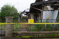 A house damaged by the March 2011 earthquake and left unprepared. Namie, Fukushima Prefecture, Japan, August 2, 2013. The town of Namie was evacuated following the nuclear accident of March 2011. Residents can only return for short periods to tend to their former homes and pick up belongings, and are not permitted to stay overnight.