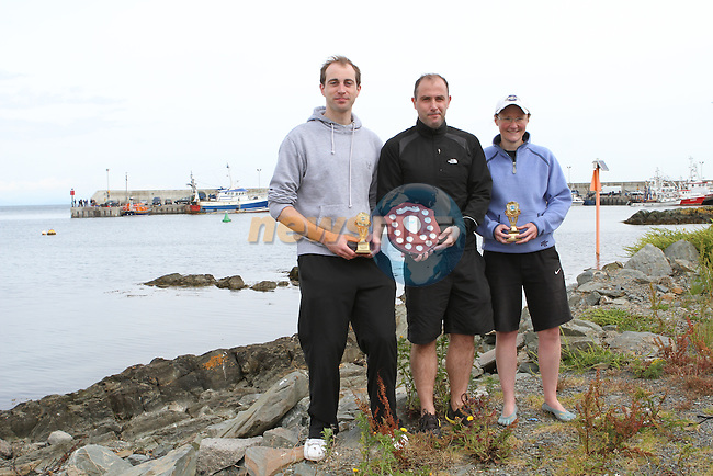 "1st Place Mark Watters, 2nd Place Oran Kane and 2nd Place Ladies Alison Cardwell at the Clogherhead ""Round the Head Swim""....(Photo credit should read Jenny Matthews/NEWSFILE)..."