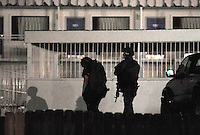 NWA Democrat-Gazette/ANDY SHUPE<br /> Law enforcement representatives carry rifles Tuesday, Sept. 8, 2015, on the north side of the Motel 6 on College Avenue in Fayetteville after a report of a man who had barricaded himself in the business.