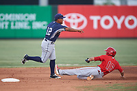 Shortstop Bryan Torres (12), of the AZL Padres 1, throws to first base over Jose Guzman (16) to complete a double play during an Arizona League game against the AZL Angels on August 5, 2019 at Tempe Diablo Stadium in Tempe, Arizona. AZL Padres 1 defeated the AZL Angels 5-0. (Zachary Lucy/Four Seam Images)