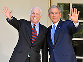 Washington, DC - March 5, 2008 -- United States President George W. Bush, right, and United States Senator John McCain (Republican of Arizona), left, the presumptive 2008 Republican nominee for President of the United States wave to reporters after endorsing the Senator's candidacy in the Rose Garden of the White House on Wednesday, March 5, 2008..Credit: Ron Sachs / CNP