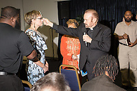 Reverend Bob Larson blesses Crystal McKnight as he performs exorcisms at Miracle Life Ministries International Church, a charismatic deliverance church, in Raleigh, NC Sunday, October 15, 2017. (Justin Cook for The Sun)