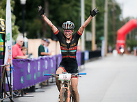 NWA Democrat-Gazette/CHARLIE KAIJO Erin Huck of Boulder, Colo. reacts as she crosses the finish line to place first in the women's race of the Epic Rides Oz Trails championship mountain bike race, Sunday, October 7, 2018 at the downtown square in Bentonville.<br />