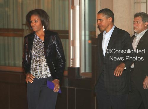 United States President Barack Obama and First Lady Michelle Obama leave Tosca Restaurant on Saturday, May 7, 2011. .Credit: Dennis Brack / Pool via CNP