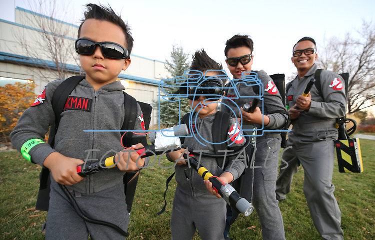 The Boholst family, from left, Spencer, 6, Greyson, 5, Chase, 9, and dad Jake check for ghosts at the Carson City Boo-nanza on Wednesday, Oct. 25, 2017. Co-hosted by Carson City Parks and Recreation, the Carson City Library and the Carson City Aquatics Facility, the Halloween event includes trick-or-treating, a haunted house, games, crafts and a dive-in movie.<br /> Photo by Cathleen Allison/Nevada Momentum