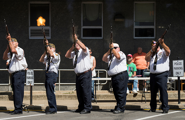 Local veterans fire rifles in salute during the presentation of the colors at the West Virginia Freedom Festival in downtown Logan, W. Va., on July 5, 2014. (Photo By Bill Clark/CQ Roll Call)