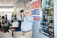 People take pictures of former Pennsylvania senator and Republican presidential candidate Rick Santorum after he spoke to an audience at the Concord office of New England College in Concord, New Hampshire.