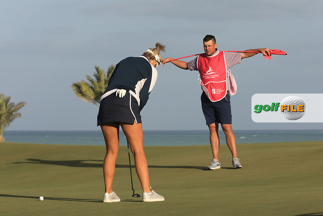 Sam Walker (ENG) caddying for Amy Boulden (WAL) during the second round of the Fatima Bint Mubarak Ladies Open played at Saadiyat Beach Golf Club, Abu Dhabi, UAE. 11/01/2019<br /> Picture: Golffile | Phil Inglis<br /> <br /> All photo usage must carry mandatory copyright credit (© Golffile | Phil Inglis)