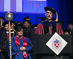 Khaled Keshk, chair and associate professor of religious studies, serves as one of the university marshals Sunday, June 11, 2017, during the DePaul University College of Science and Health and College of Liberal Arts and Social Sciences commencement ceremony at the Allstate Arena in Rosemont, IL. (DePaul University/Jamie Moncrief)