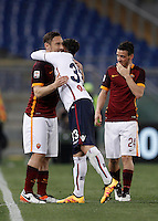 Calcio, Serie A: Roma vs Bologna. Roma, stadio Olimpico, 11 aprile 2016.<br /> Bologna's Matteo Brighi, center, greets Roma's Francesco Totti, left, during the Italian Serie A football match between Roma and Bologna at Rome's Olympic stadium, 11 April 2016.<br /> UPDATE IMAGES PRESS/Isabella Bonotto