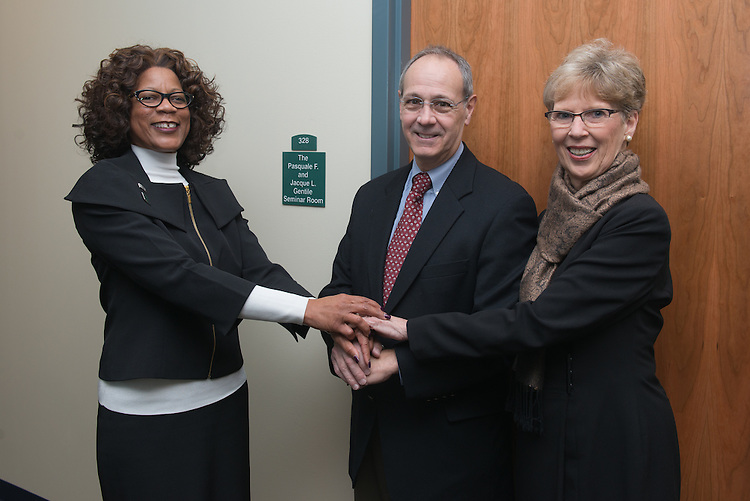 Pasquale and Jacque Gentile, right, along with Dean Renee Middleton, left, stand beside the new seminar room on the third floor of the newly renovated McCracken Hall on January 27, 2017.