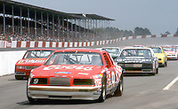 Bill Elliott's Ford Thunderbird leads the field off of pit road before the Southern 500 at Darlington Raceway in Darlington SC on September 1, 1985. (Photo by Brian Cleary/www.bcpix.com)