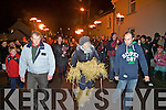 Strong tradition in Portmagee as an old man(Andrew Kennedy) representing 2011 is paraded through the town before finally being put down to allow the heralding of the New Year, he is being escorted here by l-r; Vincent O'Connell & Ian O'Connell.