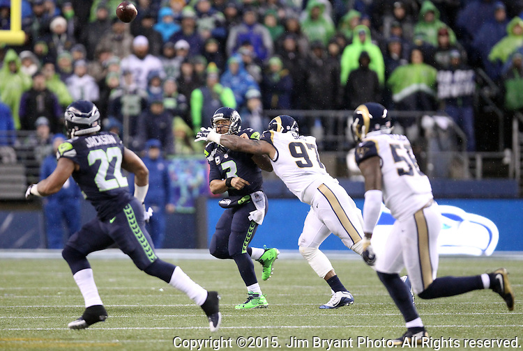 Seattle Seahawks quarterback Russell Wilson (3) looks to pass as he scrambles against the St. Louis Rams at CenturyLink Field in Seattle, Washington on December 27, 2015.  The Rams beat the Seahawks 23-17.      ©2015. Jim Bryant Photo. All Rights Reserved