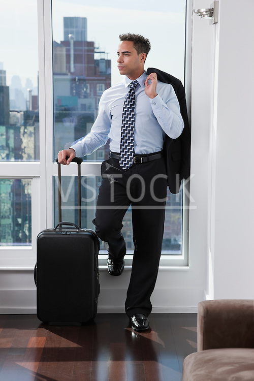 USA, New York State, New York City, business man standing by window
