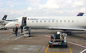 Passengers arrive on their Delta flight to the Atlanta Hartsfield-Jackson International Airport (ATL) in Atlanta, Georgia on Sunday October 2, 2005. The Atlanta based airlines filed for bankruptcy on Wednesday September 14, 2005, citing rising fuel costs $60 - $70 per barrel) and high cost structures in a low-fare world. Photo by Jane Therese/Sipa