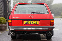 Rear view of the Mercedes W123 series 230TE estate version, outside the Penderyn Whisky Distillery in south Wales, UK. Tuesday 19 June 2018