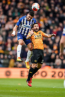 7th March 2020; Molineux Stadium, Wolverhampton, West Midlands, England; English Premier League, Wolverhampton Wanderers versus Brighton and Hove Albion; Neal Maupay of Brighton & Hove Albion and João Moutinho of Wolverhampton Wanderers compete in the air for the ball