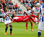 Nederland, Utrecht, 16 augustus 2015<br /> Eredivisie<br /> Seizoen 2015-2016<br /> FC Utrecht-SC Heerenveen<br /> Sebastien Haller van FC Utrecht maakt een omhaal. Lucas Bijker van SC Heerenveen kijkt toe.