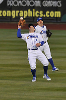 Omaha Storm Chasers right fielder Tyler Collins (7) in action with teammate Billy Burns (14) back him up against the Colorado Springs Sky Sox at Werner Park on April 5, 2018 in Omaha, Nebraska. The Sky Sox won 3-1.  (Dennis Hubbard/Four Seam Images)