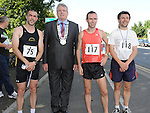 Chairperson of Louth County Council Finan McCoy pictured with Martin Quinn (2nd) Gary O'Hanlon (1st) and Brian McCloskey (3rd) at the Ardee 10k run as part of the Turfman festival. Photo: Colin Bell/pressphotos.ie