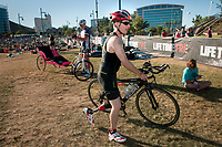 Seth O'Brien begins the cycling leg of the Lifetime Triathalon near Tempe Town Lake. He is an amputee who competes in triathalons and works a prostheticist fabricating new limbs for clients.