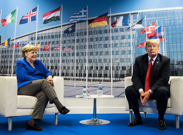 11 July 2018, Brussels, Belgium: German Chancellor Angela Merkel (L) of the Christian Democratic Union (CDU) and Donald Trump, President of the United States of America,  meet for bilateral talks at the NATO Summit. From 11 July 2018 until 12 July 2018 government heads of the 29 NATO member states and European Union representatives, will participate in the Summit of the North Atlantic Treaty Organization. Photo: Bernd von Jutrczenka/dpa /MediaPunch ***FOR USA ONLY***