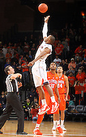 Virginia forward Akil Mitchell (25) reaches for the tip off above Clemson forward/center Devin Booker (31) during the game against Clemson Thursday in Charlottesville, VA.