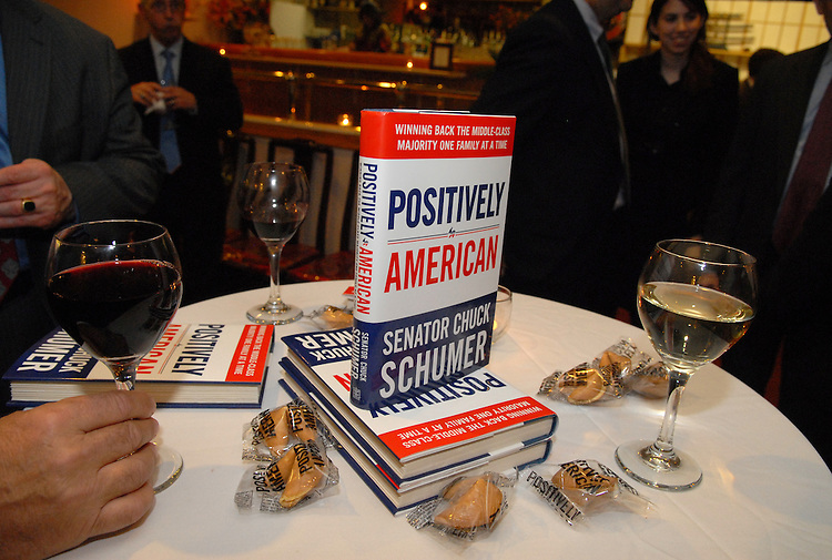 "Copies of Sen. Chuck Schumer's, D-N.Y., book ""Positively American"" is displayed at a book signing reception at the Hunan Dynasty on Capitol Hill, Tuesday, January 30, 2007."
