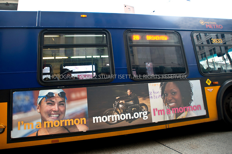"""11/17/2011--Seattle, WA, USA..The Church of Jesus Christ of Latter-day Saints has launched a major expansion of its """"I'm a Mormon"""" advertising campaign, which hopes to educate the public and dispel myths about the religion. Here some of the Church's bus ads can be seen on King County Metro buses running in downtown Seattle, WASH..©2011 Stuart Isett. All rights reserved."""