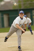 Right handed pitcher Nic Taylor pitches during a Little League game at Memorial Park in Belton, Missouri on May 6, 2006.
