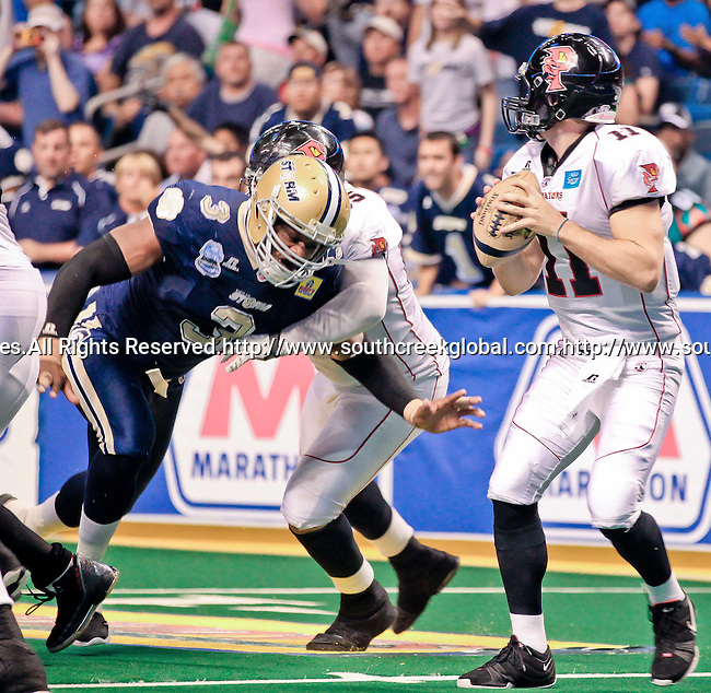 Aug 14, 2010: Orlando Predator quarterback Nick Hill (#11) feels the pressure from Tampa Bay Storm defensive back Kelvin Kinney (#3). The Storm defeated the Predators 63-62 to win the division title at the St. Petersburg Times Forum in Tampa, Florida. (Mandatory Credit:  Margaret Bowles)
