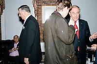 Former Virginia governor and Republican presidential candidate Jim Gilmore speaks with Daily Caller reporter Alex Pfeiffer (brown jacket) at the Gilmore primary watch party at Fratello's in Manchester, New Hampshire, on the day of primary voting, Feb. 9, 2016. Gilmore finished in last place among major Republican candidates still in the race with a total of 150 votes.