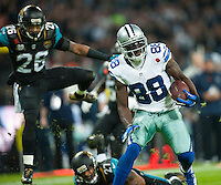 09.11.2014.  London, England.  NFL International Series. Jacksonville Jaguars versus Dallas Cowboys. Cowboys' Dez Bryant (#88) runs in for a touchdown