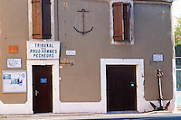 Gruissan village. La Clape. Languedoc. A door. Window. Tribunal des Prud'hommes Pecheurs - the court of prudhommes, work law, for fishermen. France. Europe.