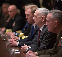 Senior military leadership, including Secretary of Defense James Mattis (2nd right) participate in a meeting with U.S. President Donald J. Trump at The White House in Washington, DC, March 9, 2018.<br /> <br /> CAP/MPI/RS<br /> &copy;RS/MPI/Capital Pictures