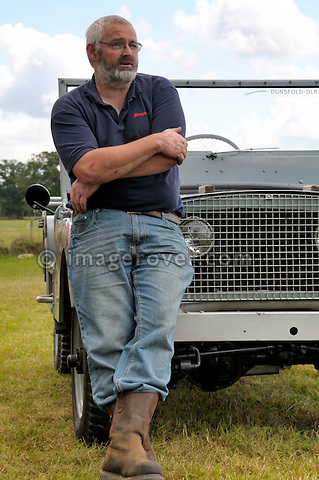 Phil Bashall at the Land Rover Centre Steer replica, built to represent the original Jeep/Rover prototype from 1947. Dunsfold Collection of Land Rovers Open Day 2011, Dunsfold, Surrey, UK. --- No releases available, but releases may not be necessary for certain uses. Automotive trademarks are the property of the trademark holder, authorization may be needed for some uses. --- Vehicle Information: Vehicle belongs to the Dunsfold Collection of Land Rovers: Engine Rover car 1.5 ltr 4-cyl petrol, Gearbox 4-speed. --- Vehicle History: This is a replica of the original Jeep / Rover prototype from 1947. The running gear was Jeep with a Rover main gearbox and engine. It has been built from photos to a very exacting scale. The original was broken up when the first pre productions were being trailed so does not exist, contrary to many rumours. There were at least 2 stages of the Centre Steer with changes for tyres, chassis, axle paint colours, winch mock up and many minor changes. This replica was built to represent the last stage of development. It is a very good copy of what the original model would have looked like.