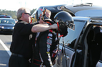 Mar. 15, 2013; Gainesville, FL, USA; NHRA crew member helps funny car driver Blake Alexander during qualifying for the Gatornationals at Auto-Plus Raceway at Gainesville. Mandatory Credit: Mark J. Rebilas-