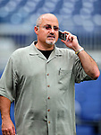 3 July 2009: Washington Nationals' acting General Manager Mike Rizzo talks on his cellphone prior to a game against the Atlanta Braves at Nationals Park in Washington, DC. The Braves defeated the Nationals 9-8 to take the first game of the 3-game weekend series. Mandatory Credit: Ed Wolfstein Photo