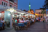 Bar in the evening near the port in Canakkale town centre, Turkey. In the distance is the minaret of the Yali Cami mosque. Canakkale is on the southern (Asian) coast of the Dardanelles. Picture by Manuel Cohen