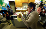 Yanira Lopez helps feed women asylum seekers in a shelter in San Antonio, Texas, on December 2, 2015. The women fled violence in Central America with their children and were detained by immigration authorities upon their arrival in the United States. Upon release from detention, they were brought to the shelter, which is run by the Refugee and Immigrant Center for Education and Legal Services (RAICES) and supported by a coalition of San Antonio churches. Shelter staff and volunteers help the women and children with food, clothing and a secure place to sleep until they can make arrangements for travel onward to stay with relatives elsewhere in the U.S., pending a final decision on their request for asylum. Lopez, herself an asylum-seeker from Guatemala, volunteers at the shelter.