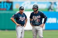 Reno Aces hitting coach Jason Camilli (3) talks to Wyatt Mathisen (21) batting during a game against the Fresno Grizzlies at Chukchansi Park on April 8, 2019 in Fresno, California. Fresno defeated Reno 7-6. (Zachary Lucy/Four Seam Images)